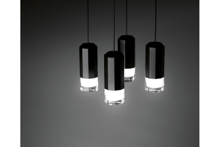 A hanging lamp which reviews and updates the chandelier look through an exercise of simplification.