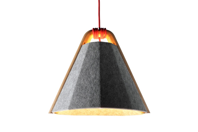 The Frankie pendant lighting system marries a finely crafted solid ash timber arm with a recycled felt panel shade.