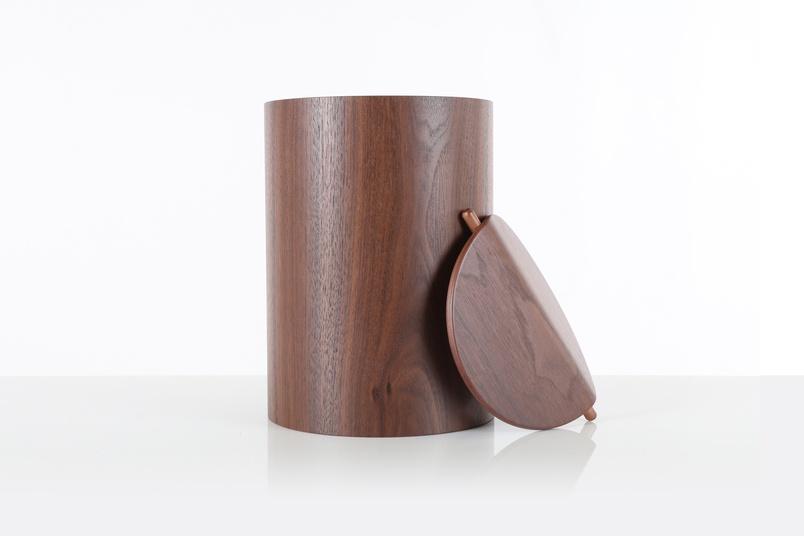 Saito (Walnut) wastebasket with lid.