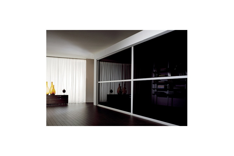 Sliding Door in living room, using LACOBEL Classic Black.