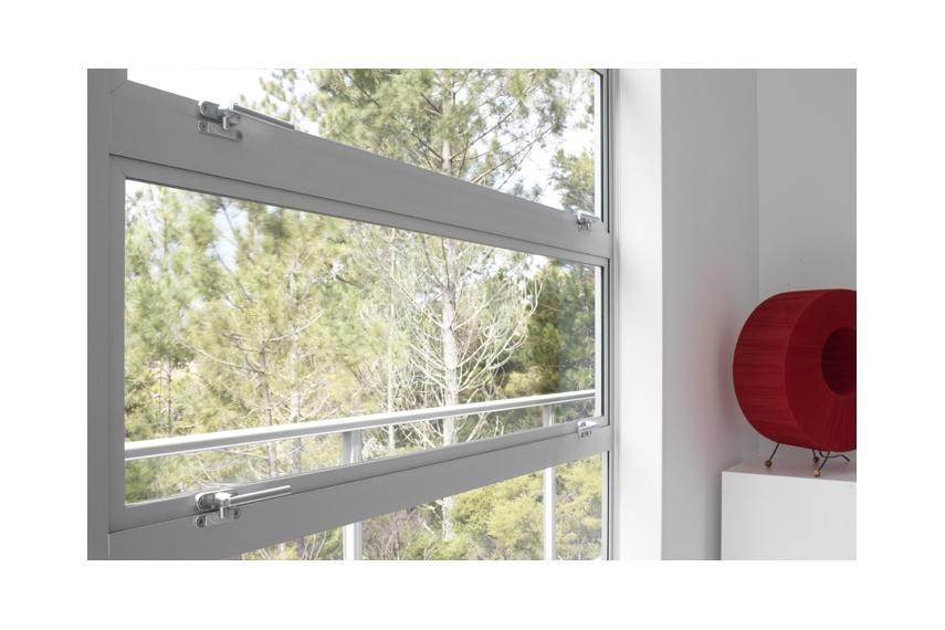 Uniform horizontal awning window banks add an interesting design feature