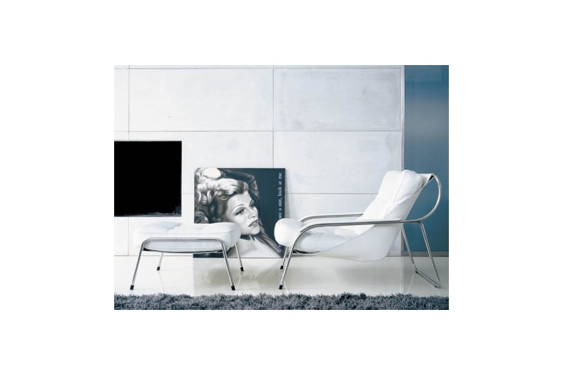 The Maggiolina chair features a stainless steel tubular frame and leather upholstery.