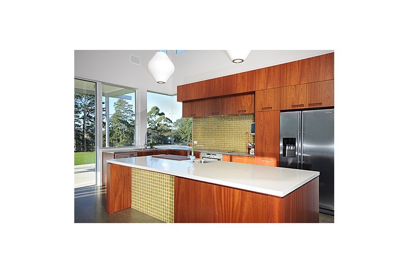 Hobsonville Kitchen – mahogany timber veneer with melamine internal carcasses, soft close drawers