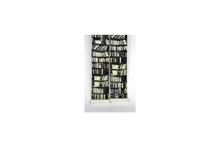 'Genuine' fake bookshelf wallpaper designed by Deborah Bowness