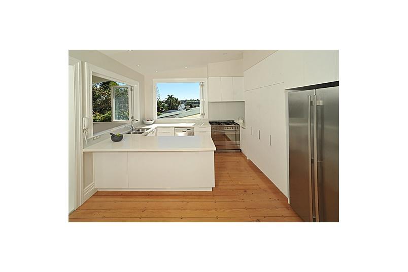 Devonport Kitchen – cabinet fronts melamine, benchtops quantum quartz, splashbacks coloured glass