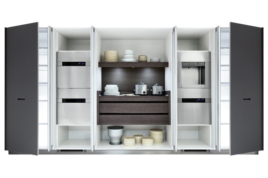 Kyton kitchen with pocket doors that completely fold open to access all appliances.
