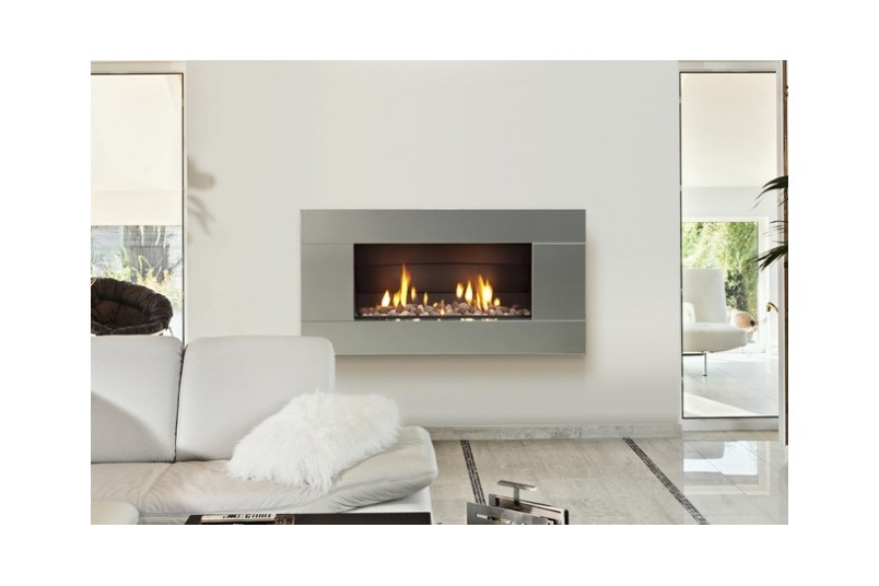 Escea ST900 gas fireplace (Stainless Steel Ferro fascia and River Pebbles fuel bed).