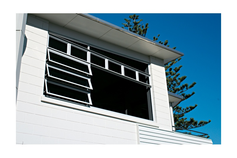 Raked windows maintain the line of the home